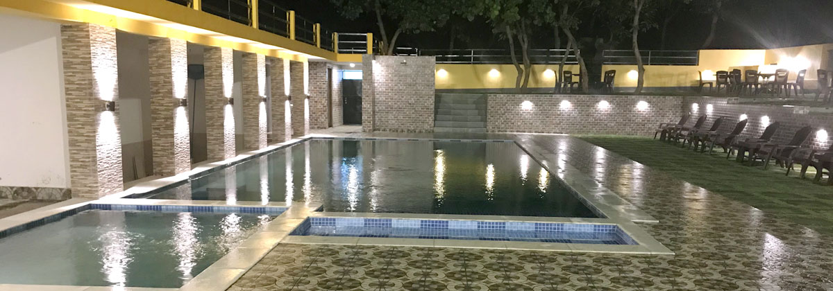 A view of the swimming pool at night. An ideal place to host the outdoor party